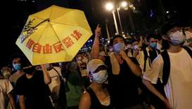 Demonstrators attend a protest to demand authorities scrap a proposed extradition bill with China, i