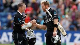 New Zealand's Colin Munro and Martin Guptill celebrate at the end of the match