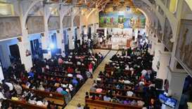 Sri Lankan Christian devotees pray during a service attended by Easter Sunday attack survivors on th