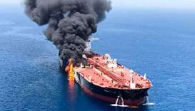 Norwegian-owned Front Altair tanker burning after it was attacked in the Gulf of Oman