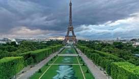 'Beyong Walls' artwork set up at Paris' landmark Champs de Mars gardens in front of the Eiffel Tower