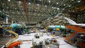Several Boeing 777X aircraft are seen in various stages of production during a media tour of the Boe