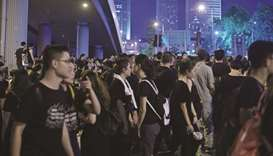 Hong Kong leader  apologises as record protest chokes city