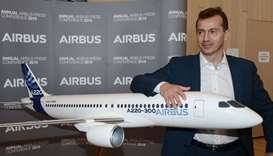 Airbus Commercial Aircraft Business Guillaume Faury poses next to an Airbus plane model