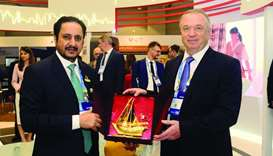Qatar Chamber chairman Sheikh Khalifa bin Jassim al-Thani handing over a token of recognition to Rus