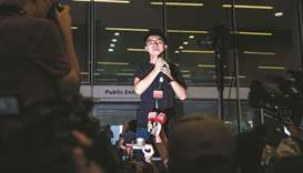 HK activist Wong walks free, vows to join protests