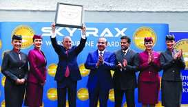 Qatar Airways Group Chief Executive HE Akbar al-Baker holding an award plaque.
