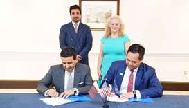 HE Dr Ali bin Fetais al-Marri signing a cooperation agreement with a US counterpart