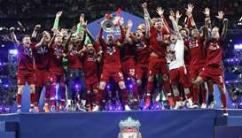 Liverpool celebrate with the trophy after winning the champions league