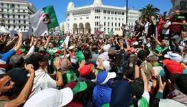 People take part in an anti-government protest in Algiers, Algeria