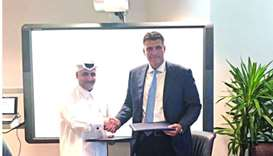 QFBA CEO Dr Khalid al-Horr and SUAS-Q executive dean Dr Ivan Ninov after signing the MoU.