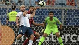 Argentina's Sergio Aguero (L) and Qatar's Boualem Khoukhi vie for the ball during the Copa America f