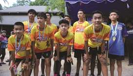 'Wild Boars' lead charity race near Thai cave