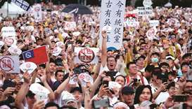 Thousands protest in Taiwan against pro-China media