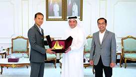 Abu Bakar receiving a token of recognition from al-Obaidli after a meeting held at Qatar Chamber's h