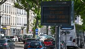 A digital diplay reads 'Ongoing pollution - more info on onlymoov' as cars drive in the French easte