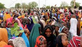 Internally displaced people (IDP) block a highway to protest against shortage of food and divertion