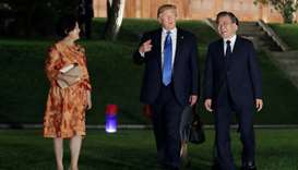 Donald Trump and South Korean President Moon Jae-in leave after a banquet at the Presidential Blue H