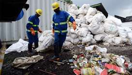 Nepali workers drag sacks of waste collected from Mount Everest for recycling, in Kathmandu