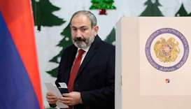 In this file photo taken on December 09, 2018 Armenia's Prime Minister Nikol Pashinyan is about to c