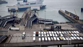 Freight lorries wait on the quayside to board a ferry, as a DFDS ferry arrives at the Port of Dover,