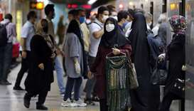 Iranians wearing face masks are pictured in a subway station in the capital Tehran on June 10