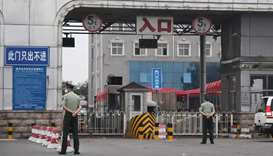 Chinese paramilitary police officers guard an entrance to the closed Xinfadi market in Beijing