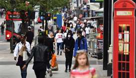 Shoppers walk a a busy Oxford Street in London as some non-essential retailers reopen from their cor