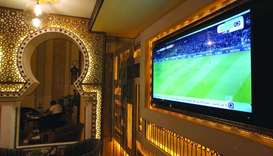 A TV broadcast of Bundesliga highlights, pirated by beoutQ, is seen at a local cafe in Khobar, Saudi