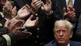 U.S. President Donald Trump listens to applause after signing an executive order on police reform du