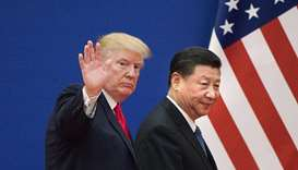In this file photo US President Donald Trump (L) and China's President Xi Jinping leave a business l