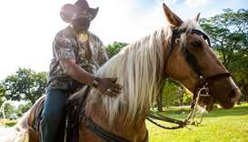 Fox Thompson rides his horse, Lakota through Washington Park