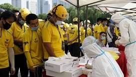 Beijing tests food and parcel couriers as coronavirus checks widen