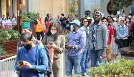 Shoppers queue at Westfield shopping centre in east London