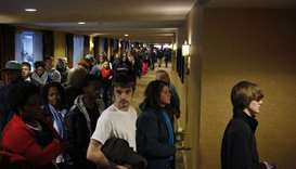 People wait in line to enter a job fair in Louisville, Kentucky.