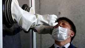 Japan allows saliva-based tests to boost coronavirus detection
