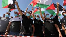 Thousands of Palestinians rally against annexation