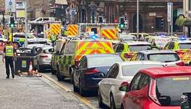 Emergency responders are seen near a scene of reported stabbings, in Glasgow, Scotland, in this pict