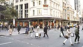 Pedestrians and shoppers cross a road at Pitt Street Mall in Sydney. One of Australia's largest pens