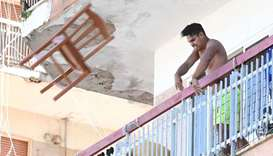 This photo taken on Thursday and provided by Italian news agency Ansa yesterday shows residents of t