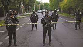 Police officers secure the area after Mexico City's public security secretary Omar Garcia Harfuch wa