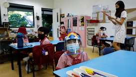 Children wearing protective face masks and shields attend preschool classes  as schools reopen amid