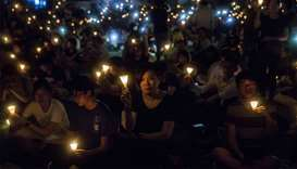 (file photo) People holding candles during a vigil in Hong Kong, to mark the 30th anniversary of the