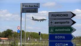 A plane lands at the Fiumicino airport  in Rome, Italy