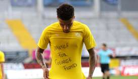 Dortmund's English midfielder Jadon Sancho removed his shirt during a goal celebration to reveal an