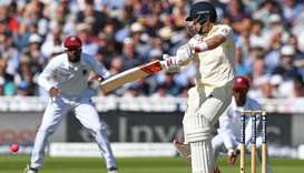 In this file photo taken on August 17, 2017, England captain Joe Root plays a shot on the opening da