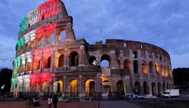 Rome's ancient Colosseum is lit with colours of the Italian flag to show unity, solidarity and to ho