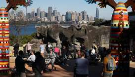 Visitors walk between enclosures at Taronga Zoo Sydney as it re-opens to the public amidst the easin