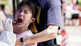 A child reacts while undergoing nucleic acid testing in Wuhan, the Chinese city hit hardest by the c