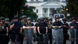 Members of the Federal Bureau of Prisons and other law enforcement block 16th Street, NW near the Wh